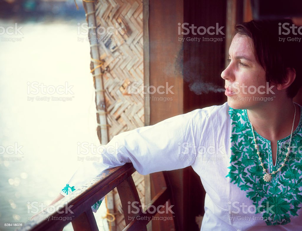 Contemplating Kerala Backwaters in houseboat. stock photo