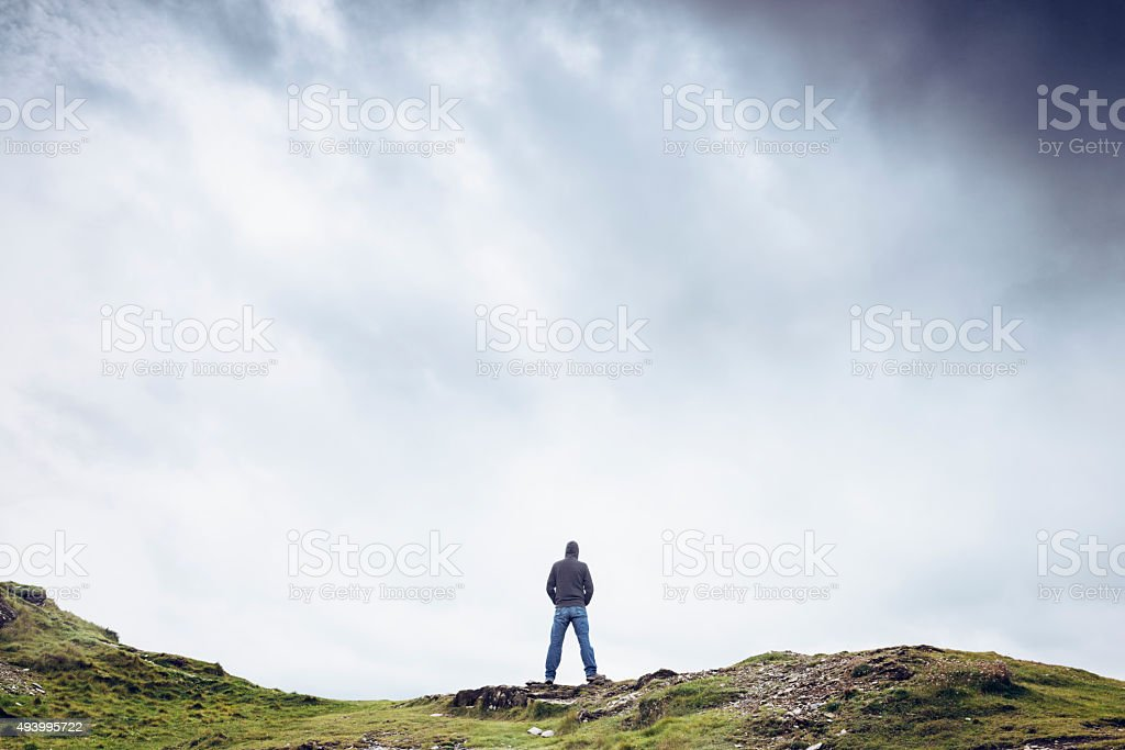 Contemplation, Looking out in gloomy conditions stock photo