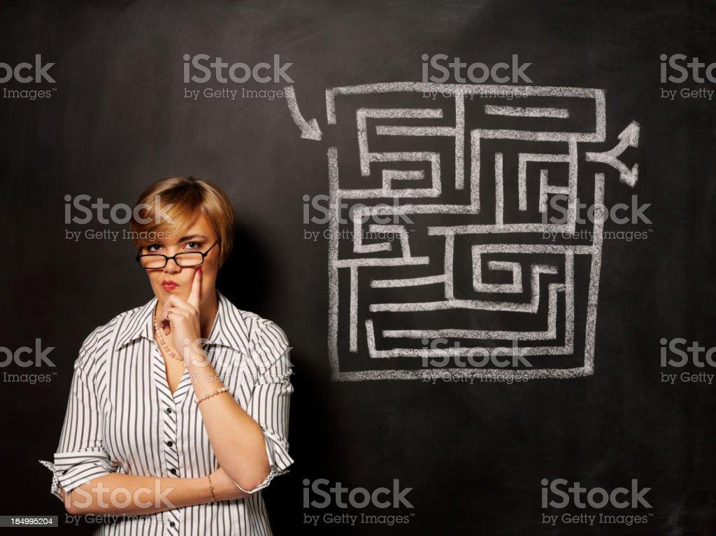 Contemplation over a Maze Puzzle stock photo