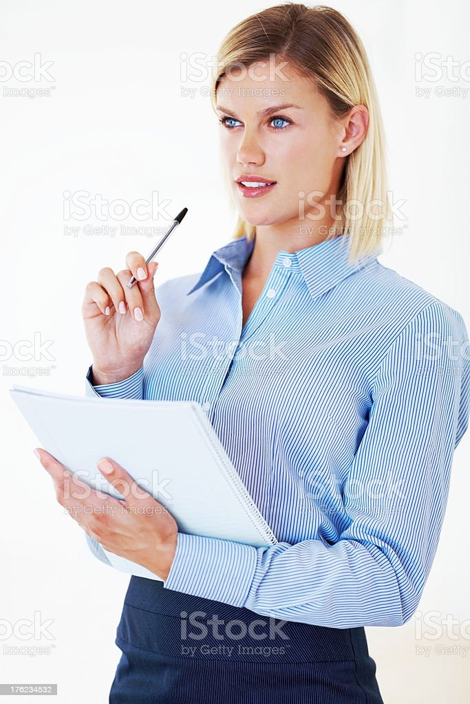 Contemplative business woman with folder stock photo
