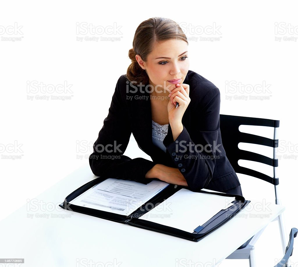 Contemplative businesswoman sitting with documents royalty-free stock photo