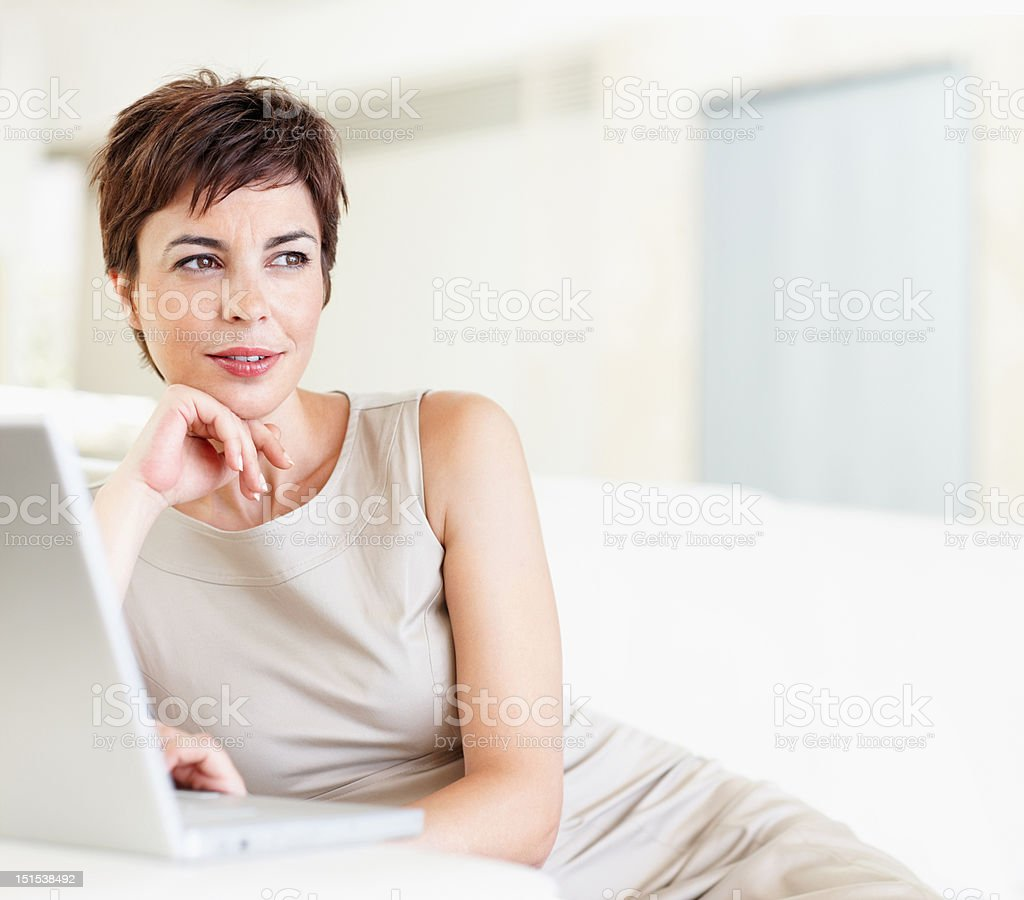Contemplative businesswoman with a laptop royalty-free stock photo
