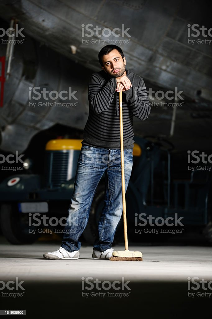 Contemplative Man with Broom royalty-free stock photo