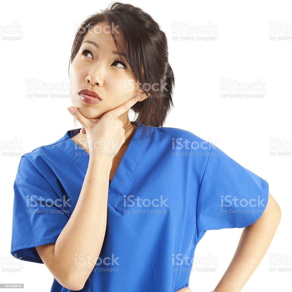 Contemplative Nurse in Blue Scrubs royalty-free stock photo
