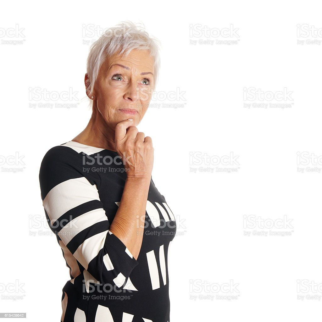 contemplative older woman looking up stock photo