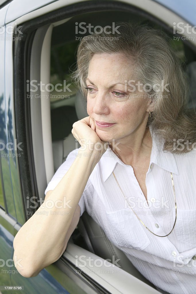 Contemplative Senior Adult Woman in her Car royalty-free stock photo
