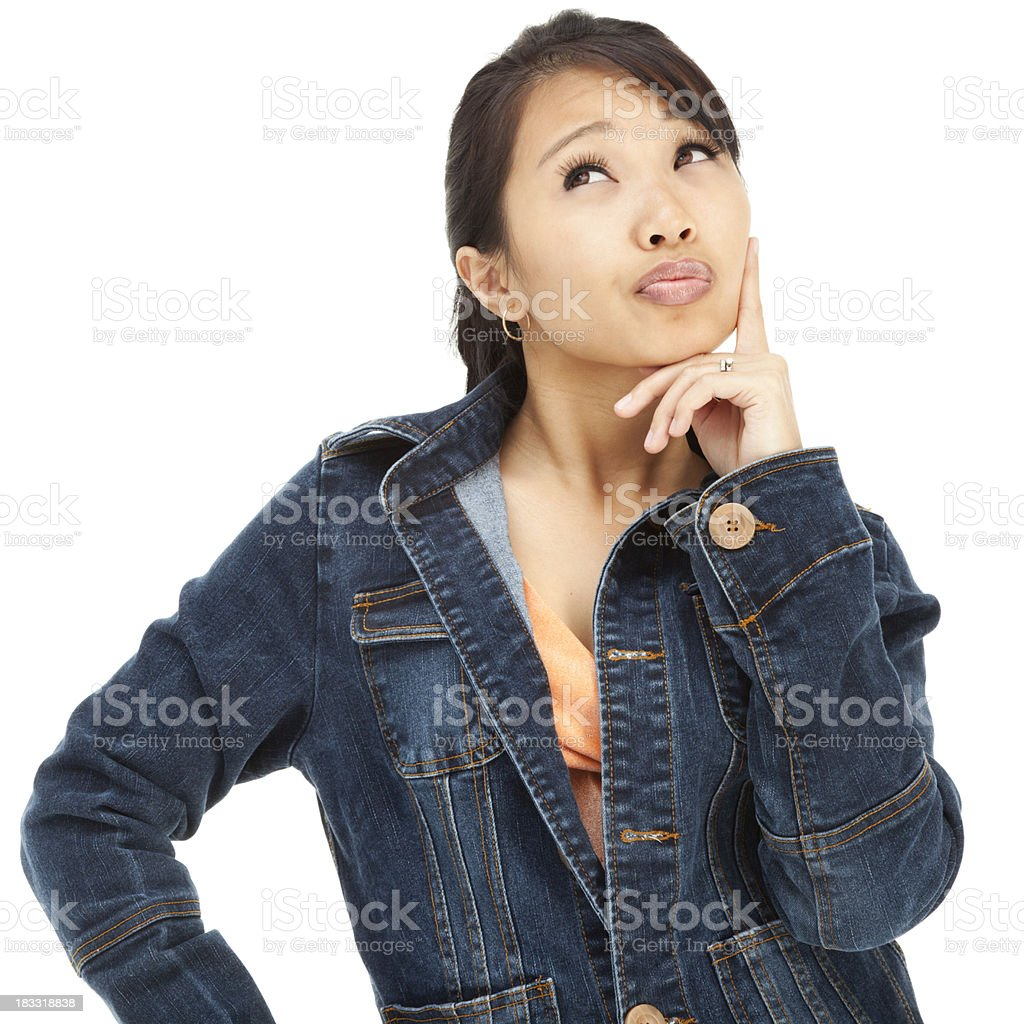 Contemplative Young Asian Woman in Blue Denim Jacket royalty-free stock photo