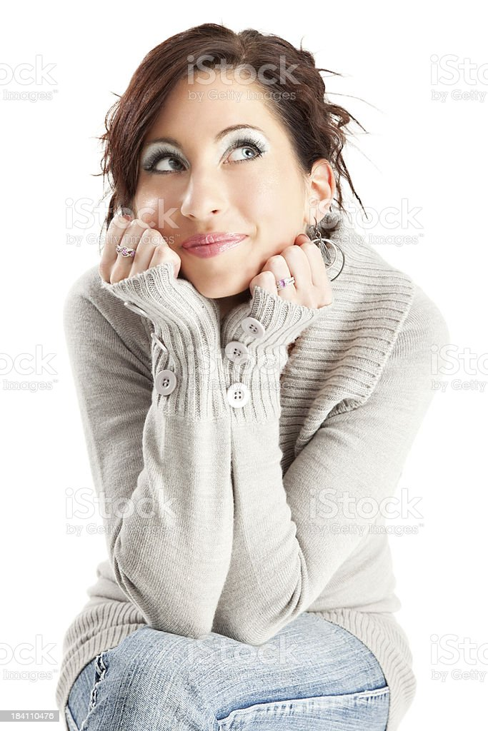 Contemplative Young Woman in Gray Sweater royalty-free stock photo