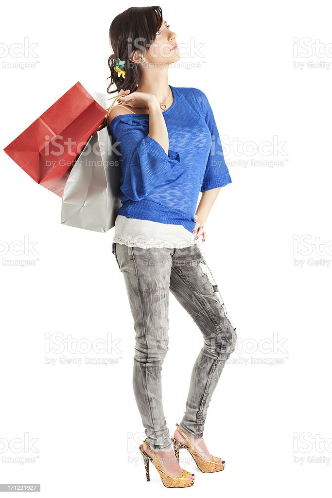 Contemplative Young Woman with Paper Shopping Bags royalty-free stock photo