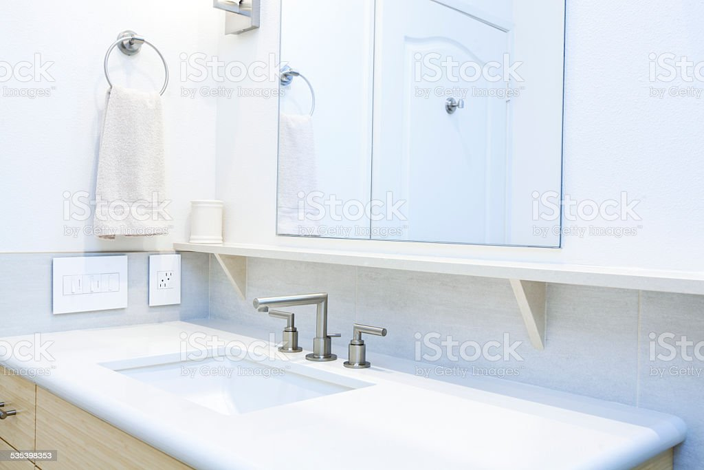 Contemporary Bathroom Design in Residential Home with Vanity andBath Sink stock photo