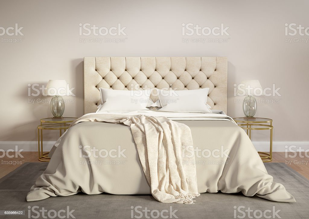 Contemporary beige bedroom with grey rug stock photo