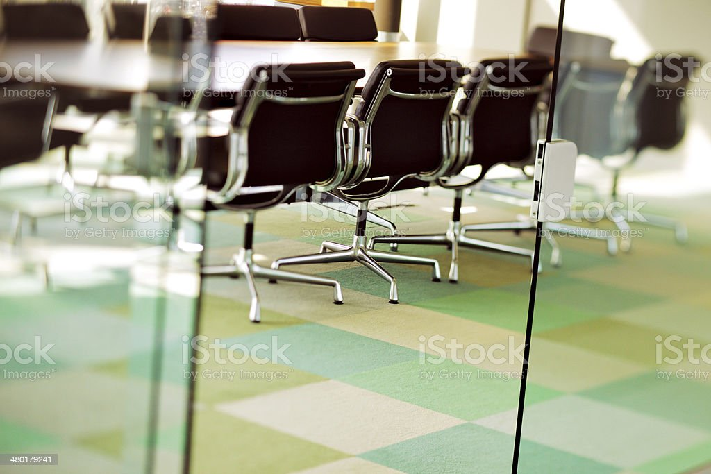 Contemporary boardroom is ready for the next board meeting stock photo