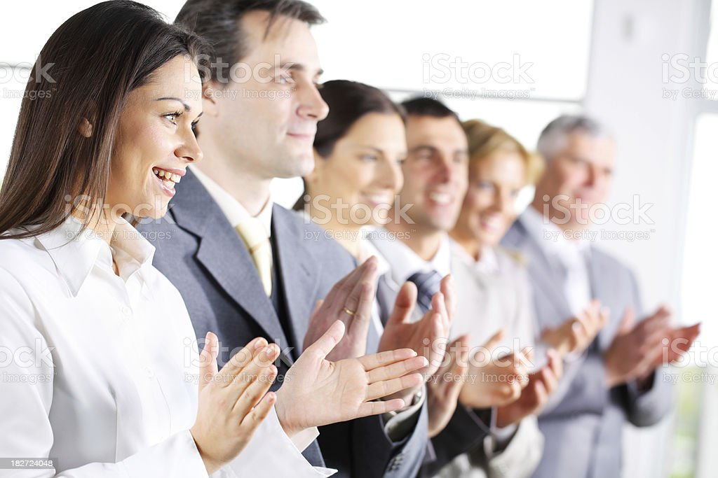 Contemporary business people applauding on a conference. royalty-free stock photo