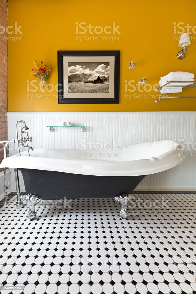 Contemporary Classic Bathroom Design with Claw Foot Tub stock photo