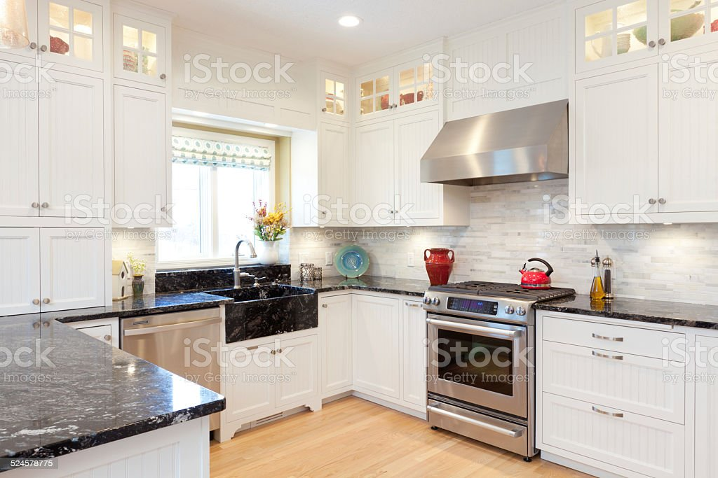 Contemporary Classic Home Kitchen Design Featuring Granite Countertops, White Cabinets stock photo