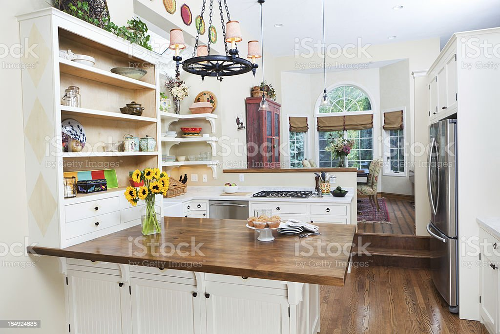 Contemporary Classically Designed Showcase Kitchen with Dinning Room royalty-free stock photo