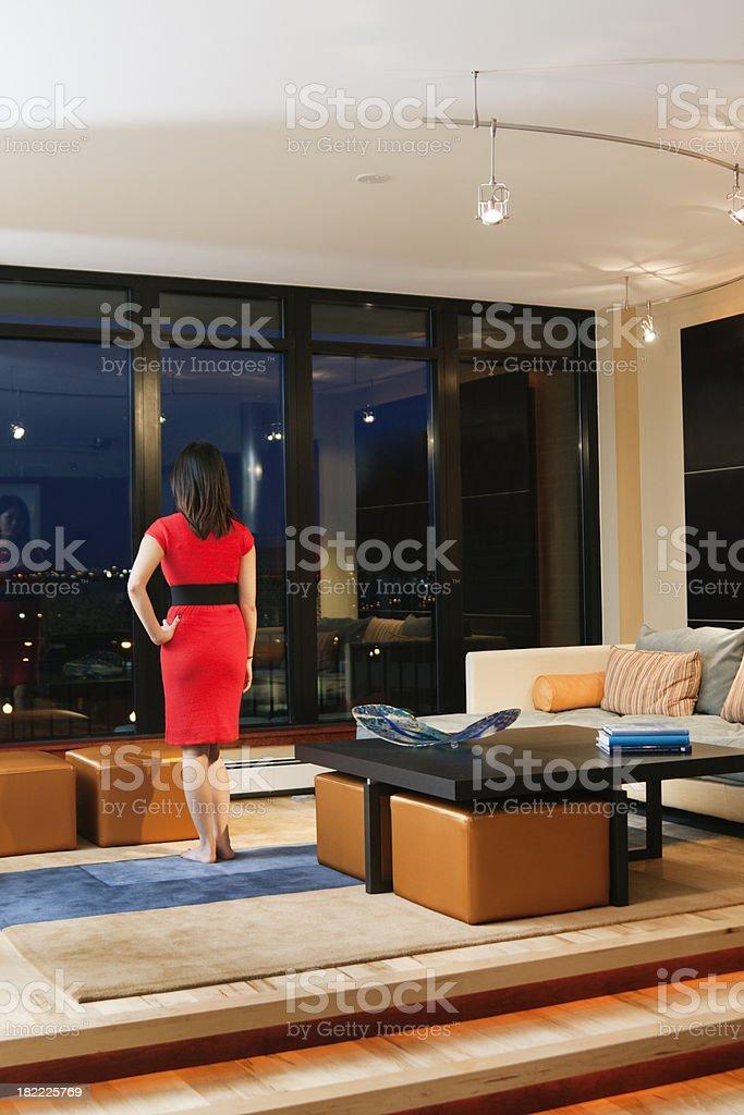 Contemporary Condominium Design—Woman's Urban Lifestyle in Living Room Vt royalty-free stock photo