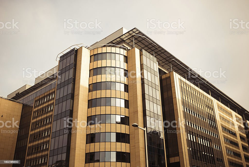 contemporary corner corporate building skyscraper reflecting in facade - Brussels royalty-free stock photo