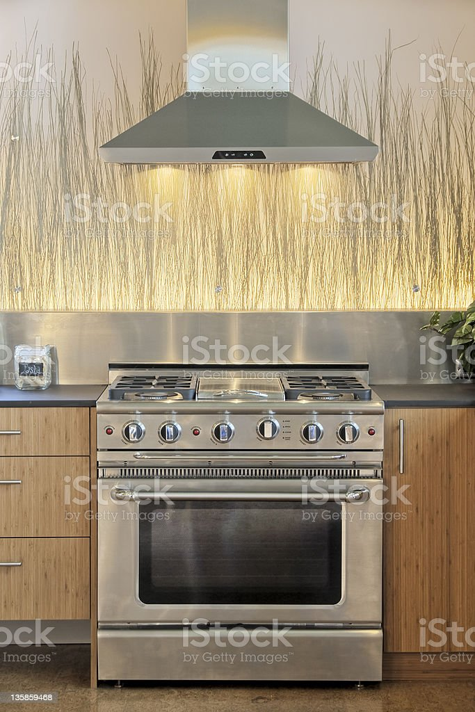 Contemporary Custom Home Kitchen with Range Hood and Backlit Glass royalty-free stock photo