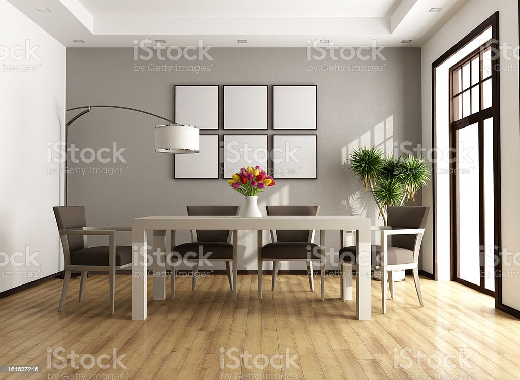 Contemporary dining room with wood floors and blank artwork royalty-free stock photo