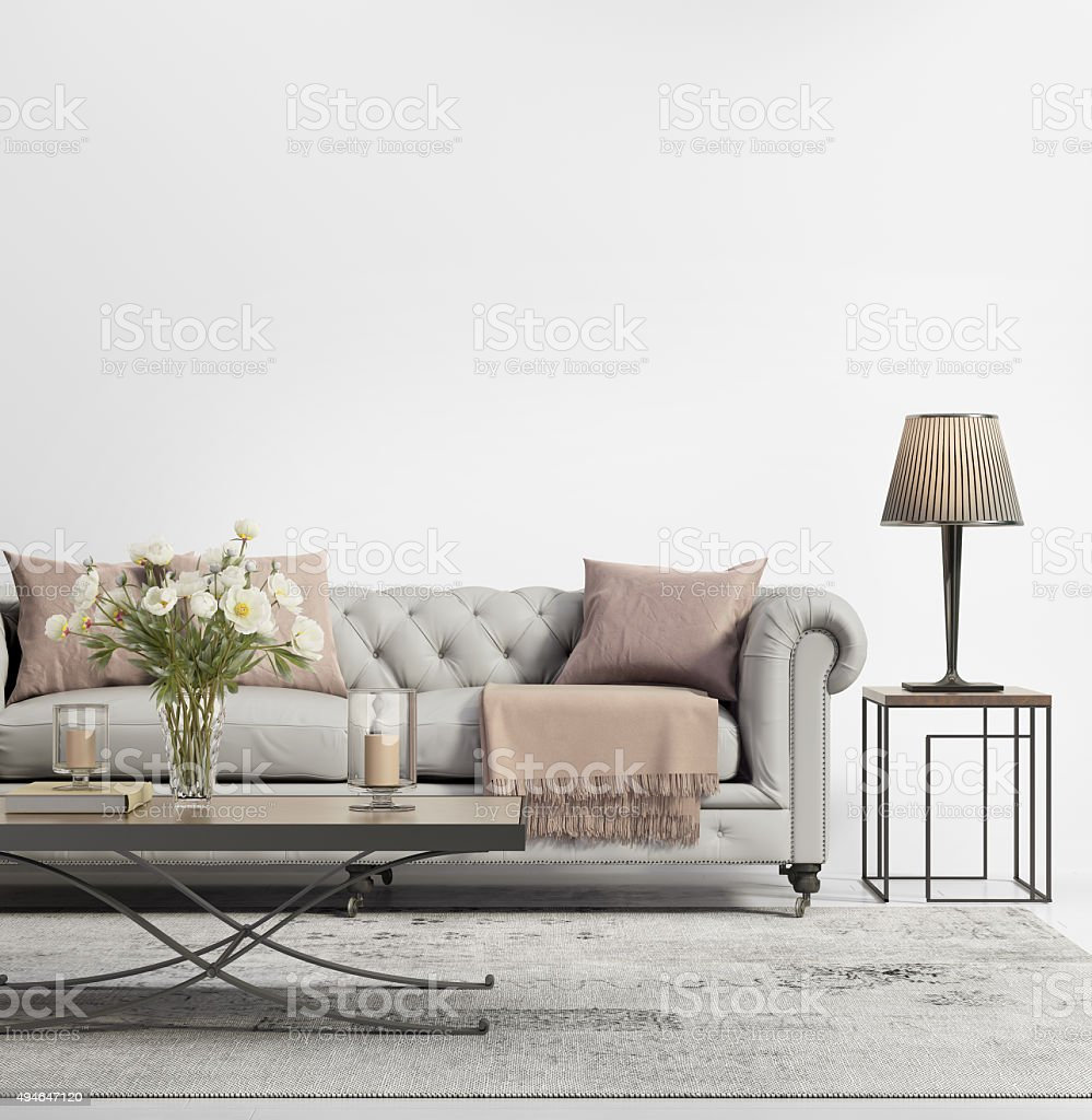Contemporary elegant chic living room with grey tufted sofa stock photo