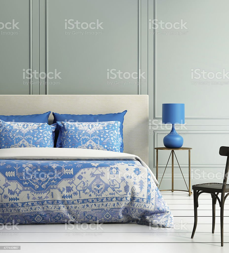 Contemporary elegant luxury atmospheric bedroom with teal wall stock photo