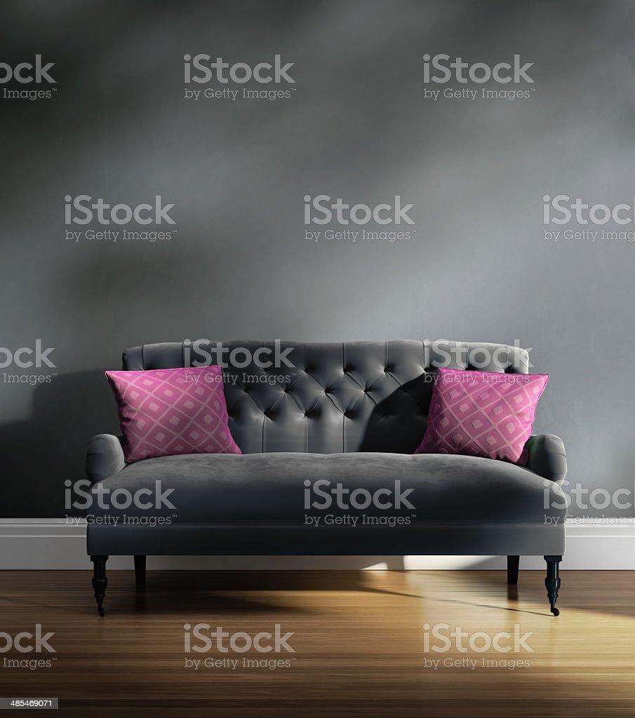 Contemporary elegant luxury grey velvet sofa with pink cushions stock photo