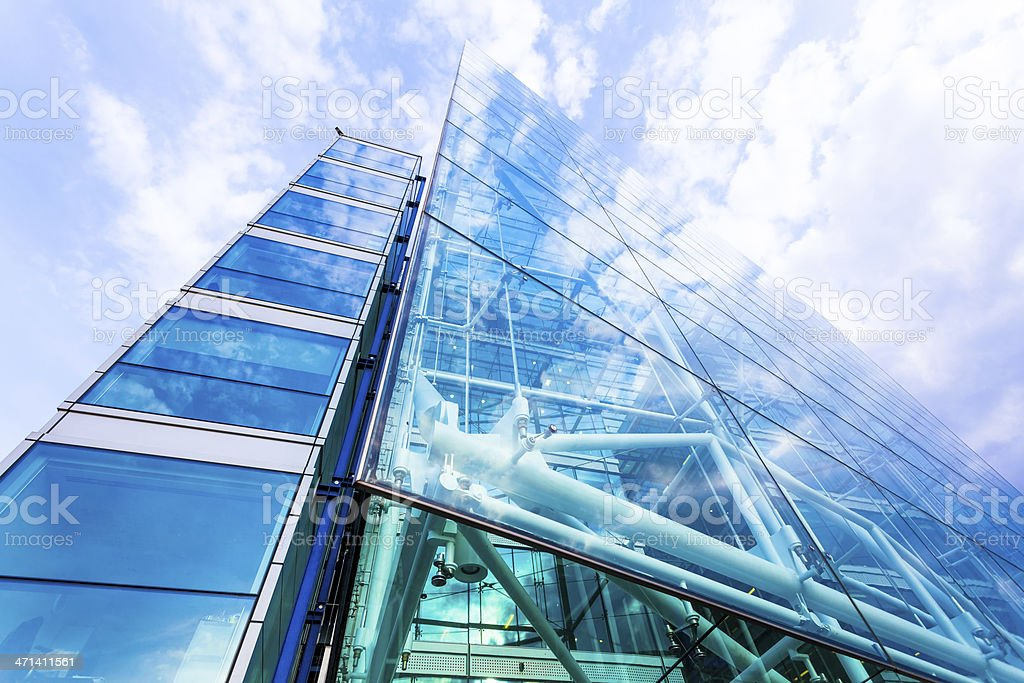 Contemporary Glass Office Building and Clouds Reflections stock photo