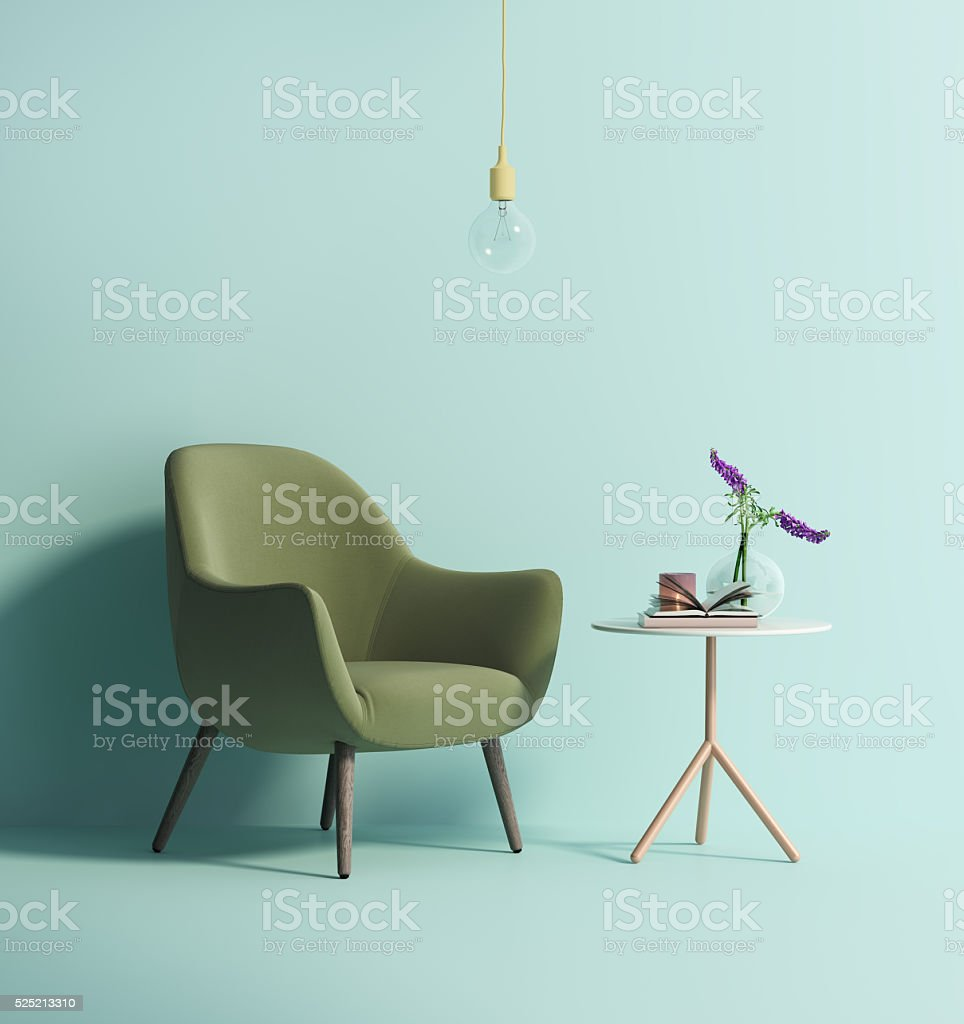 Contemporary green armchair on mint wall stock photo