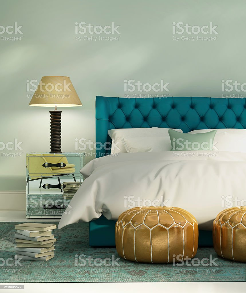 Contemporary green luxury bedroom with green bed stock photo
