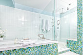 Contemporary Home Bathroom with Shower Stall, Tub and Glass Tiles