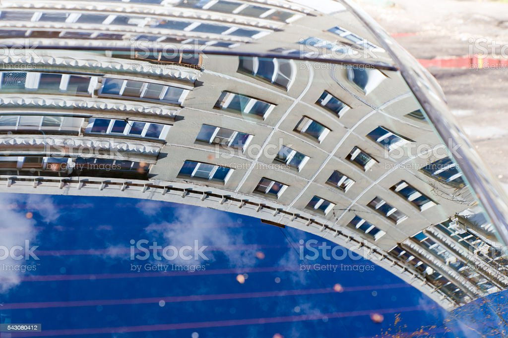 Contemporary house reflected in the window of the car stock photo