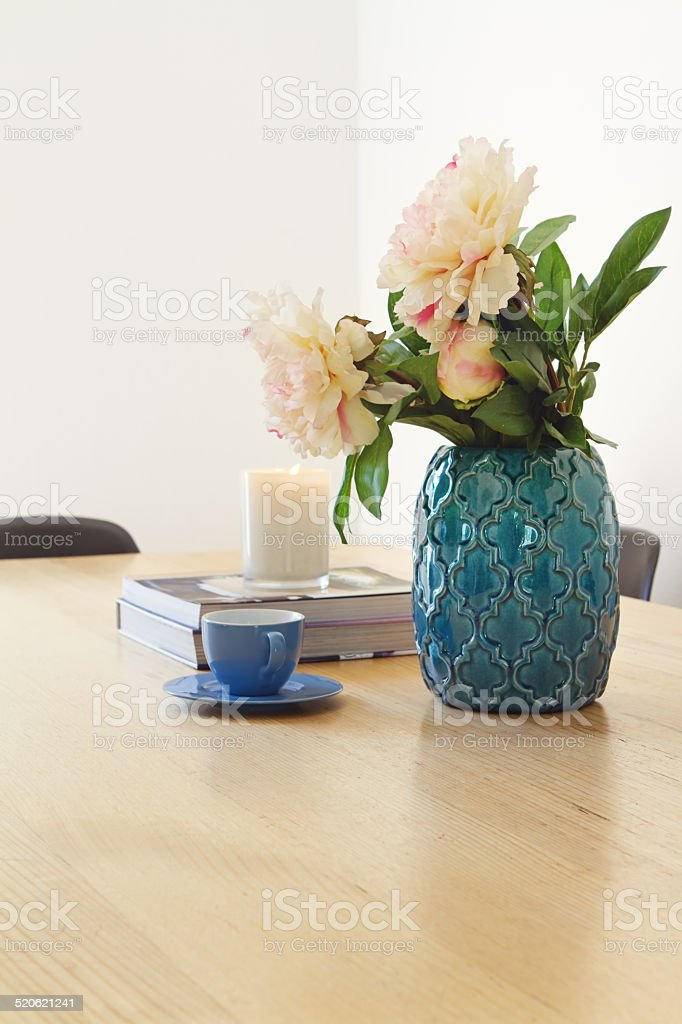 Contemporary interior dining with vase and flowers stock photo