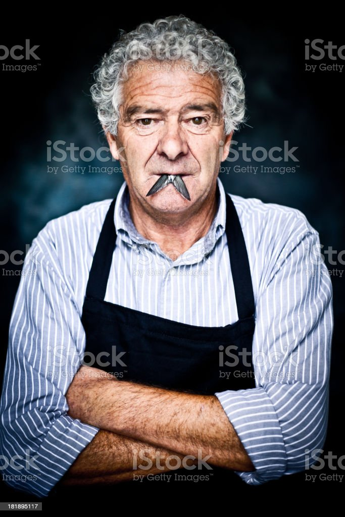 contemporary italian man with a fish in his mouth stock photo