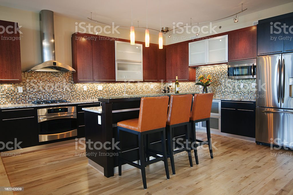 Contemporary kitchen with kitchen bar island royalty-free stock photo