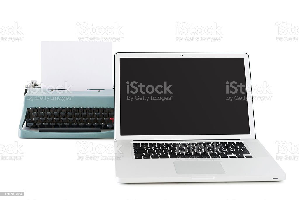 contemporary laptop in front of an old typewriter stock photo