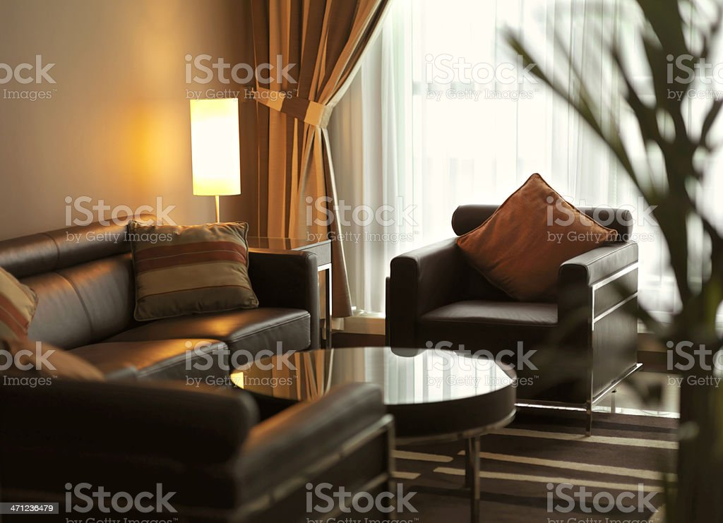 Contemporary living room with brown leather sofa stock photo