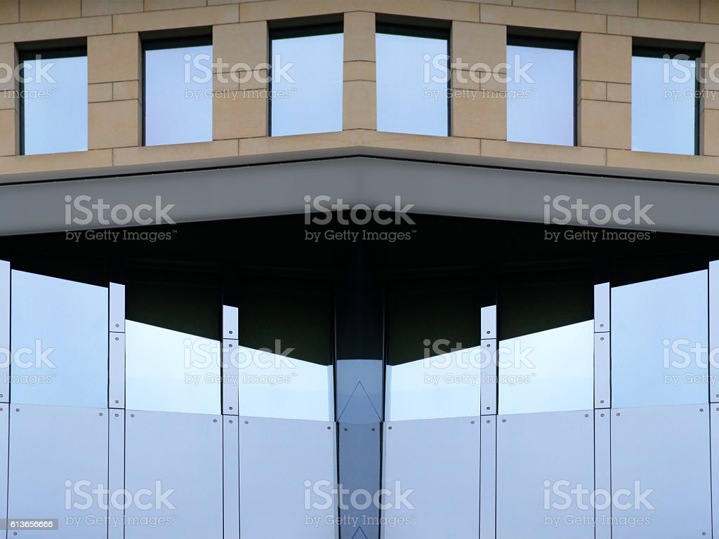 Contemporary office building with structural glazing and traditional windows stock photo