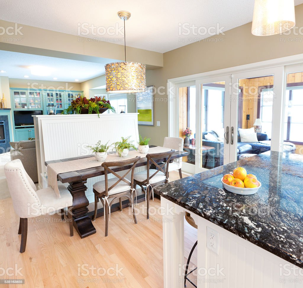 Contemporary Open Concept Kitchen Dining Room and Family Den Design stock photo