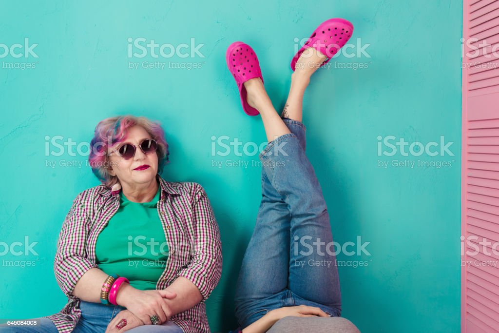 Contemporary parents and children with bright clothes and stylish hair stock photo