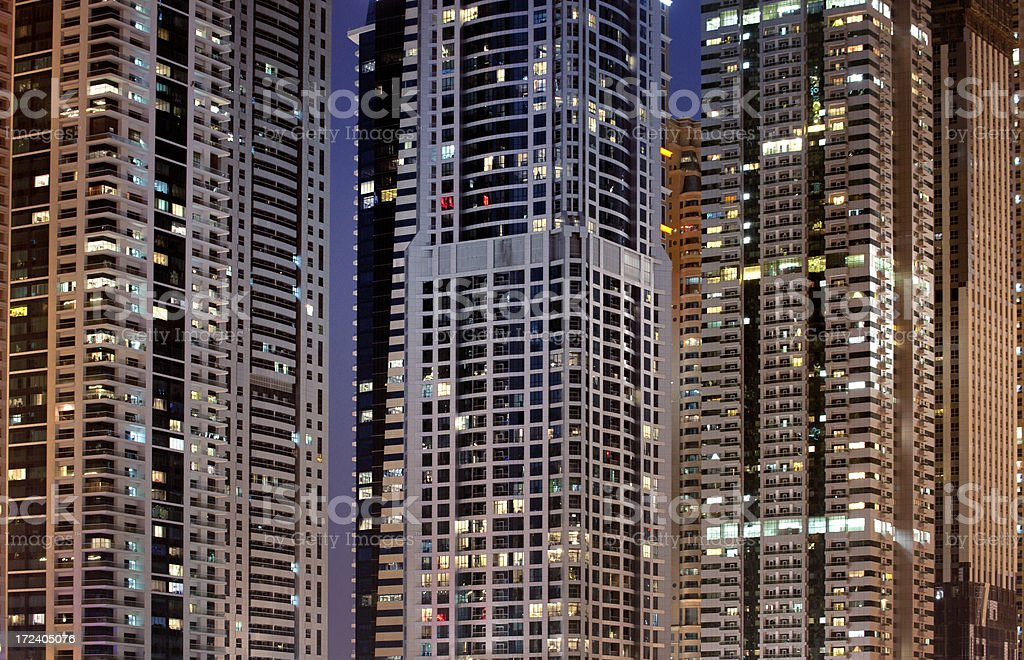 contemporary skyscrapers in Dubai at night stock photo