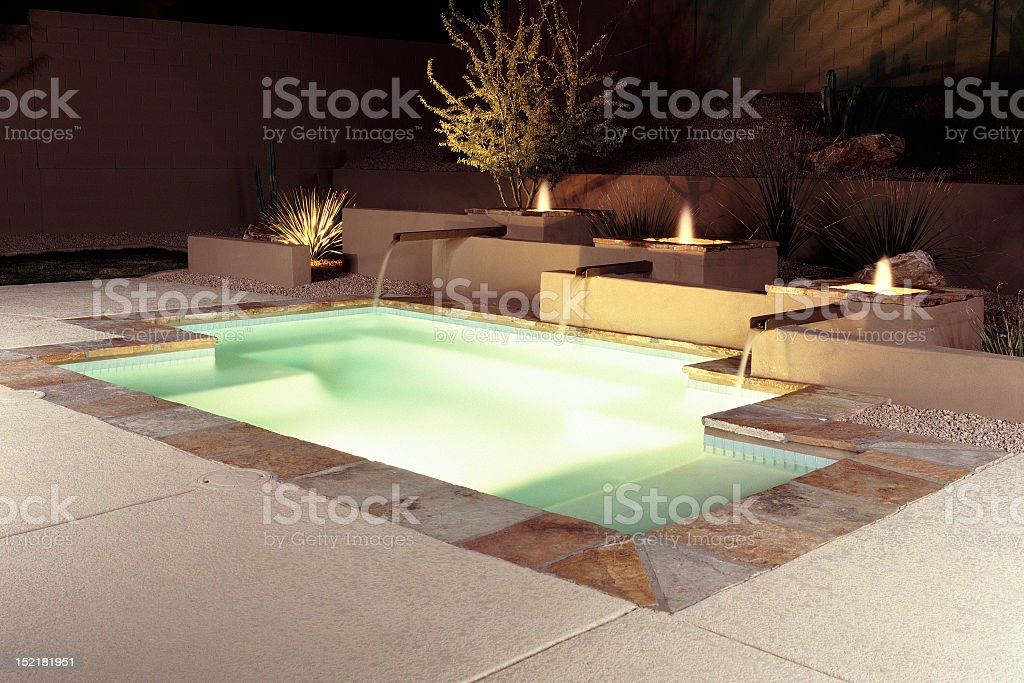 Contemporary swimming pool design on an illuminated patio stock photo