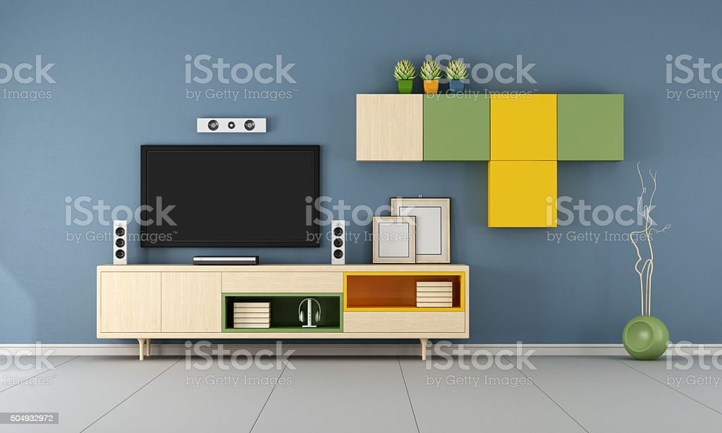 Contemporary  TV wall unit  in a blue room stock photo