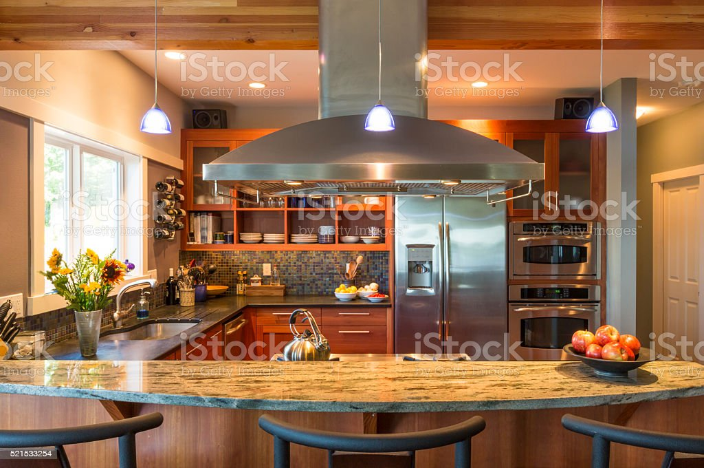 Contemporary upscale home kitchen interior with granite countertops stock photo