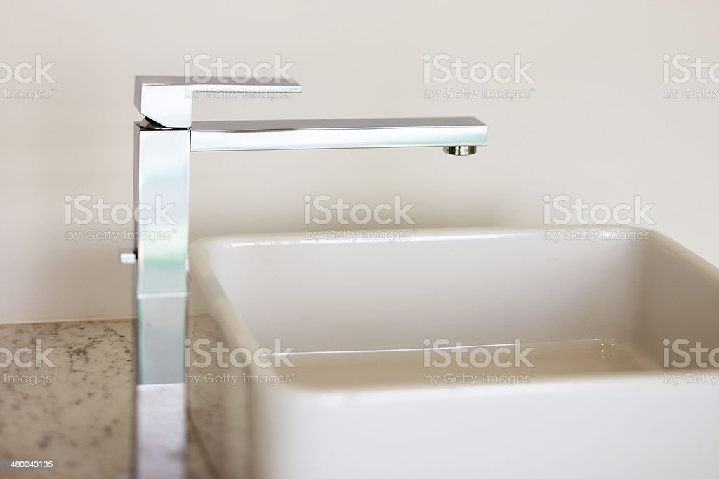 Contemporary wash-hand basin and faucet stock photo