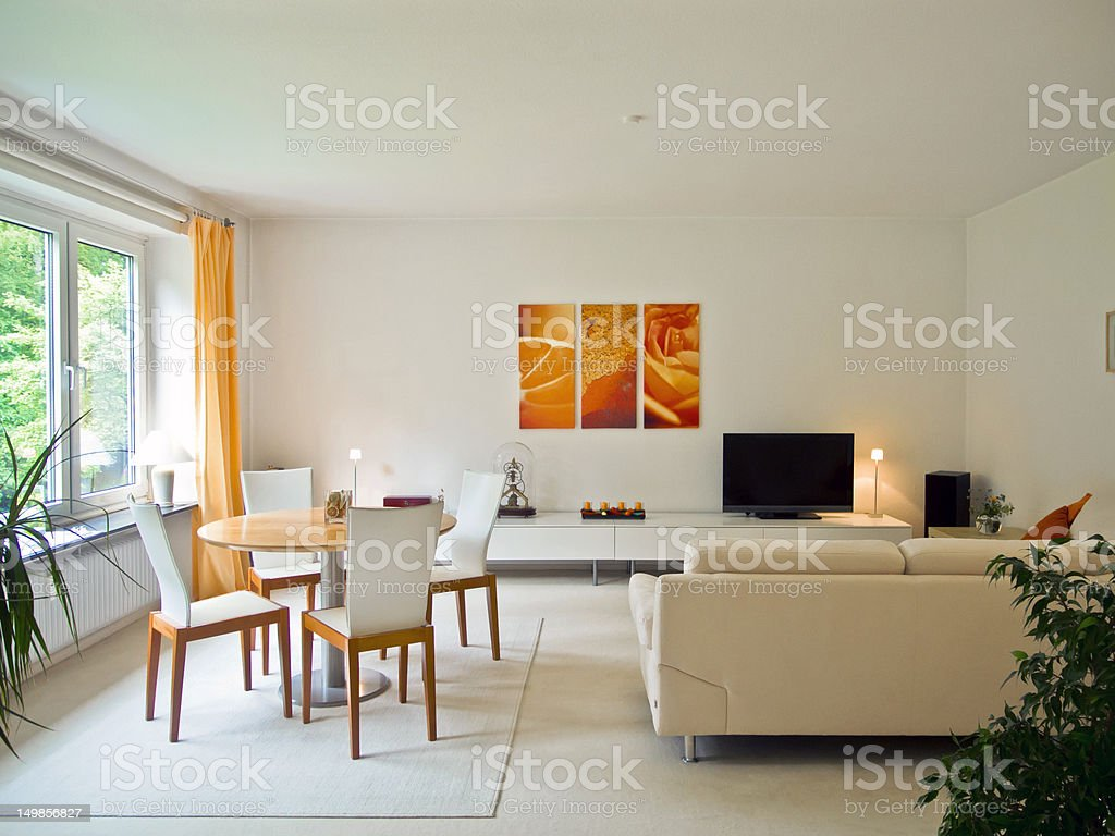 Contemporary white living room with orange accents royalty-free stock photo