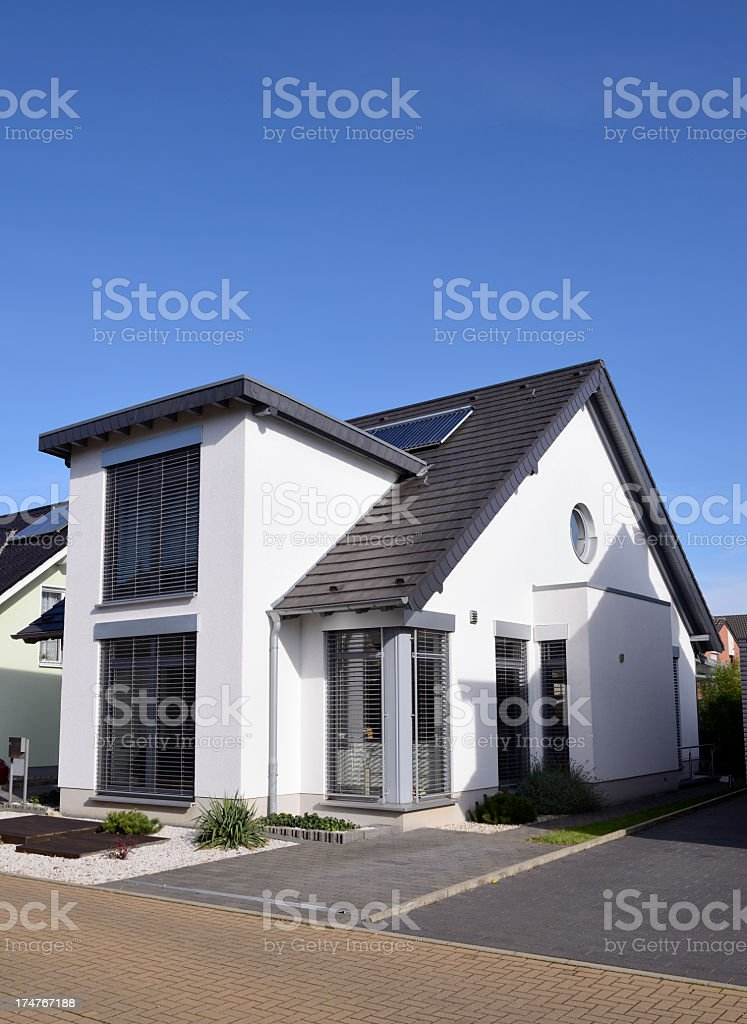 Contemporary white one-family house stock photo