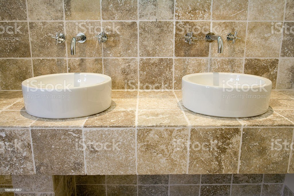 Contemporay 'his n hers' wash basins royalty-free stock photo