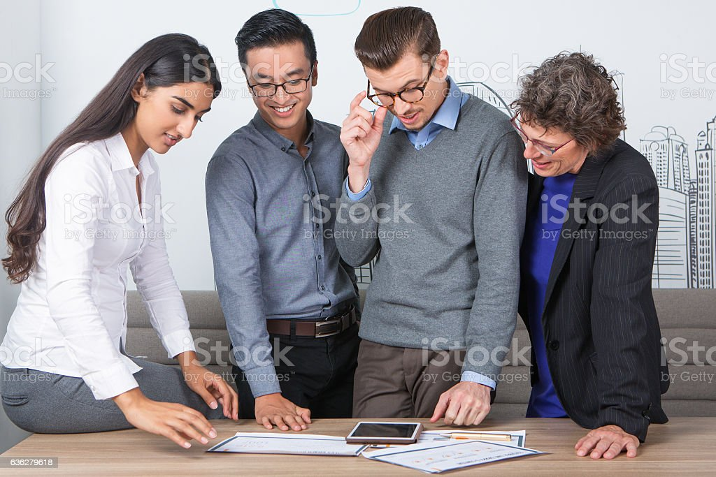 Content Business Team Standing at Desk and Working stock photo