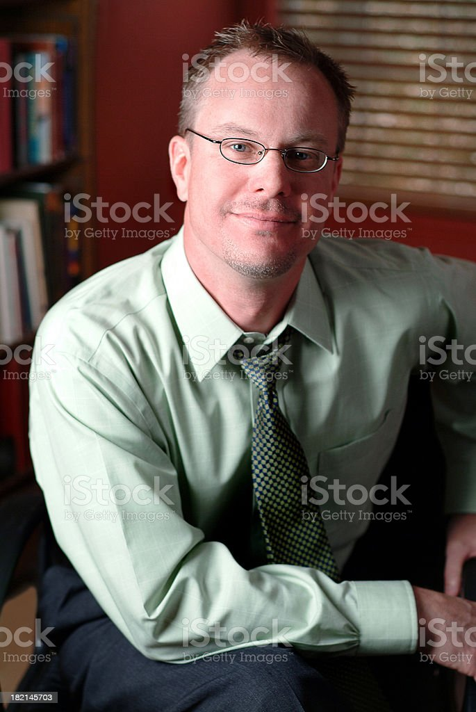 Content Businessman sitting in his Office royalty-free stock photo